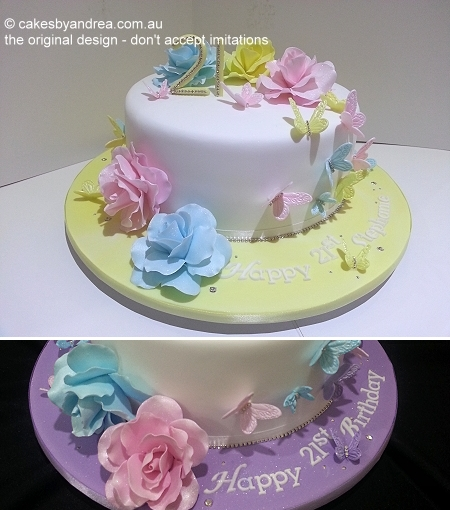 White 21st birthday cake featuring hand-made pastel roses and diamante-set number 21 on coloured fondant covered board, with embedded diamantes and name inscription. Shown in different colourways. Discuss your preferred colours with Andrea.