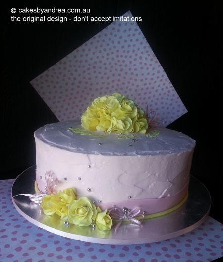 21st-cake-pink-frosted-yellow-roses