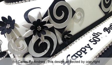 50th-birthday-cake-silver-black-swirl-geometric-black-blossoms