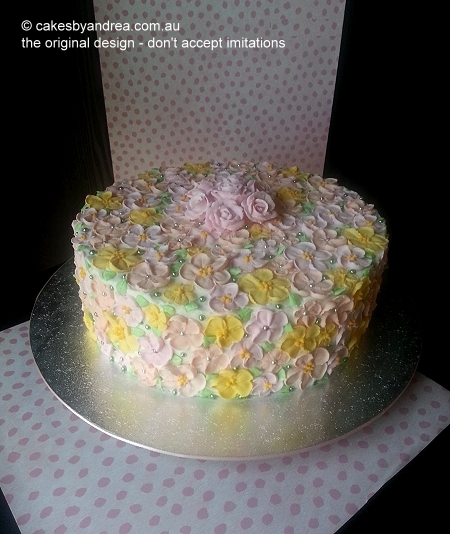 blossoms-pink-frosted-birthday-cake