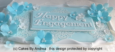 custom-cake-blue-5-petal-blossoms-plaque-lace-frosted