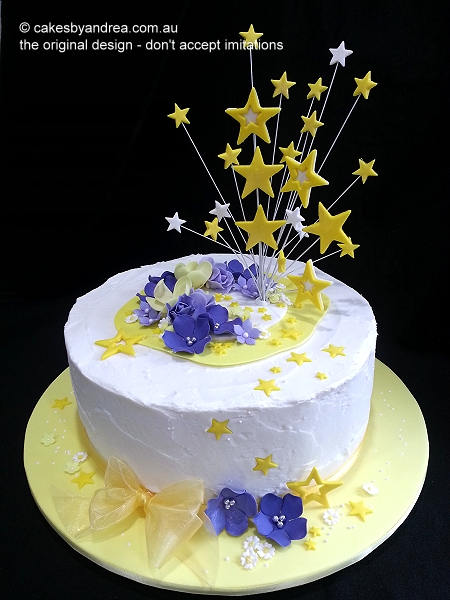 frosted-celebration-cake-yellow-stars
