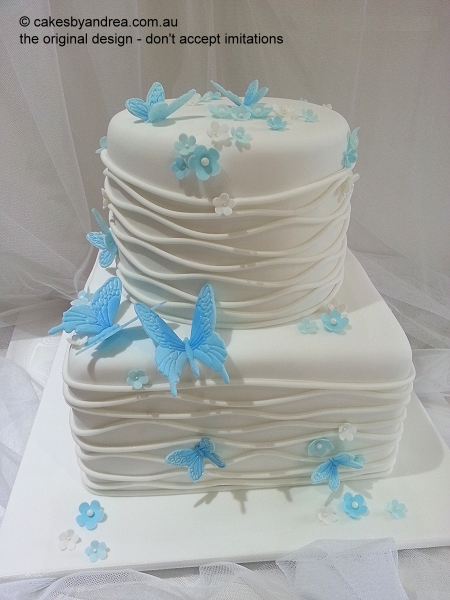 white-wedding-cake-wave-butterflies