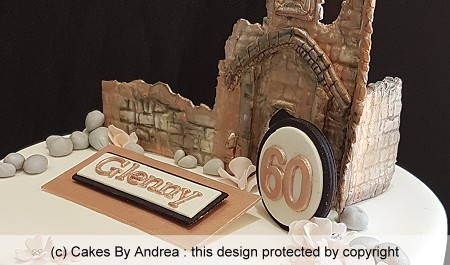 60th-birthday-cake-castle-wall-rose-gold