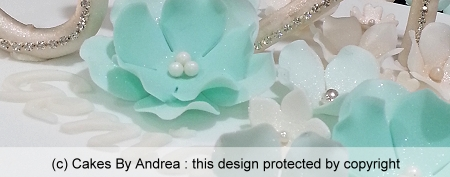 custom-wedding-cake-teal-stylised-blossoms-3-tier